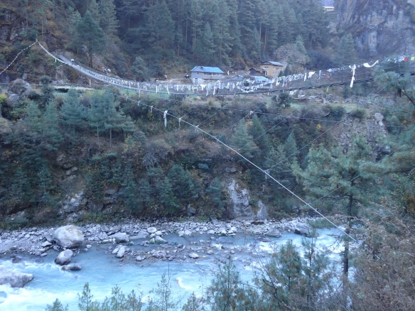 The bridge to Jorsale festooned with prayer flags. on the way to Namche Bazaar.