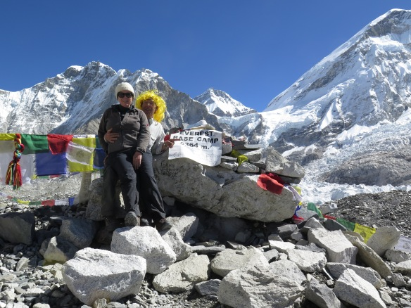 Louise Terranova with a man in a yellow wig at Everest Base Camp.