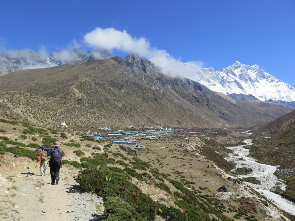 Walking into Dingboche with the river below.