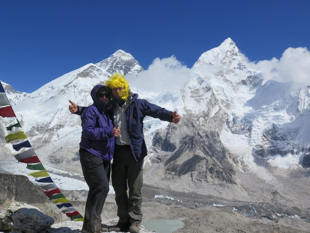 EBC Trekkers standing on Kala Patthar in front of Mount Everest and above Everest Base Camp