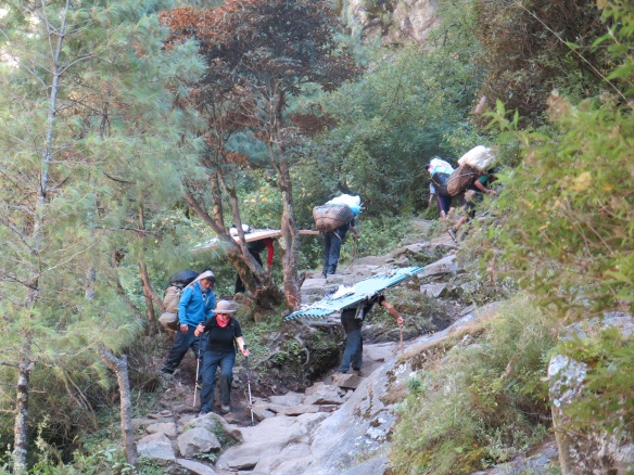 Porters climbing up to the bridge to Namche Bazaar