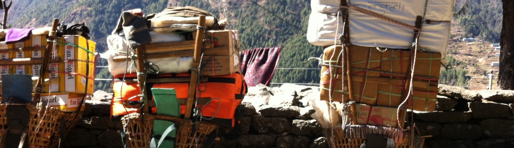 Porters loads at a resting point on the EBC Trek