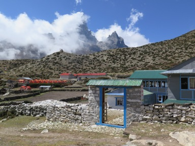 Lodge in Dingboche with mountains behind nepal everest base camp trek
