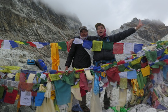 Trekker and Porter Guide on top of Cho La Pass Nepal